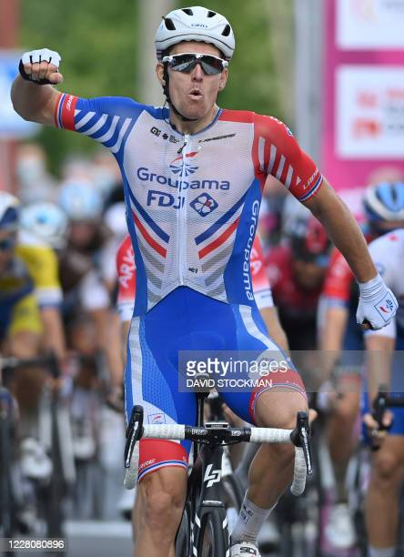 French Arnaud Demare of Groupama-FDJ celebrates as he crosses the finish line to win during the second stage of the Tour De Wallonie cycling race, 1...