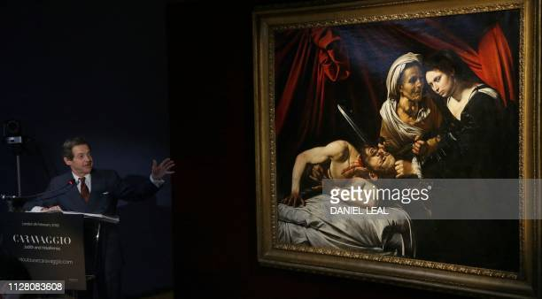 French art expert Eric Turquin speaks along side a painting believed to be the second version of Judith Beheading Holofernes by Italian artist...