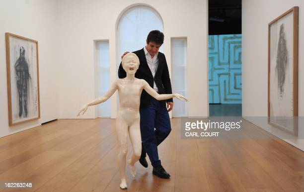 French artist Adel Abdessemed poses beside his sculpture entitled 'Cri' at the David Zwirner Gallery in central London on February 21 2013 The piece...