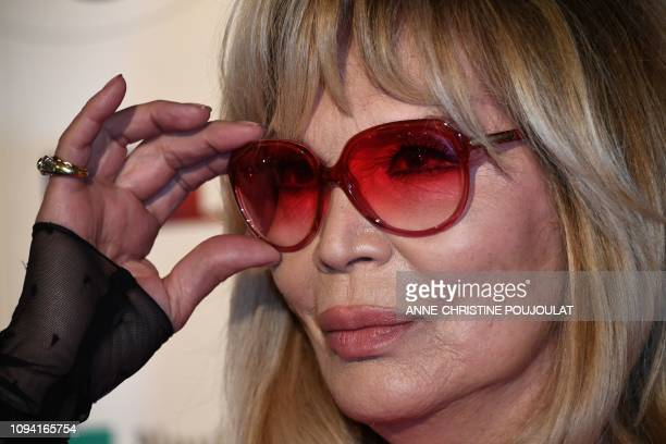 French artist Amanda Lear adjusts her glasses as she arrives for the 26th Film Francais trophies ceremony at the Palais Brongniart in Paris, on...