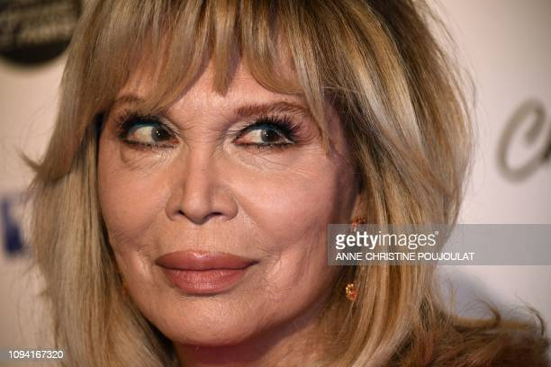 French artist Amanda Lear poses as she arrives for the 26th Film Francais trophies ceremony at the Palais Brongniart in Paris, on February 5, 2019.