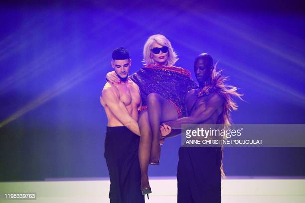 French artist Amanda Lear presents a creation by Jean Paul Gaultier during the Women's Spring-Summer 2020 Haute Couture collection fashion show in...