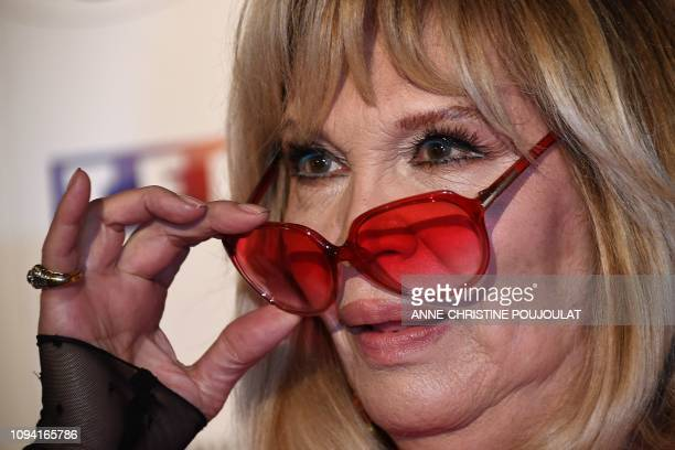 French artist Amanda Lear removes her glasses as she arrives for the 26th Film Francais trophies ceremony at the Palais Brongniart in Paris on...