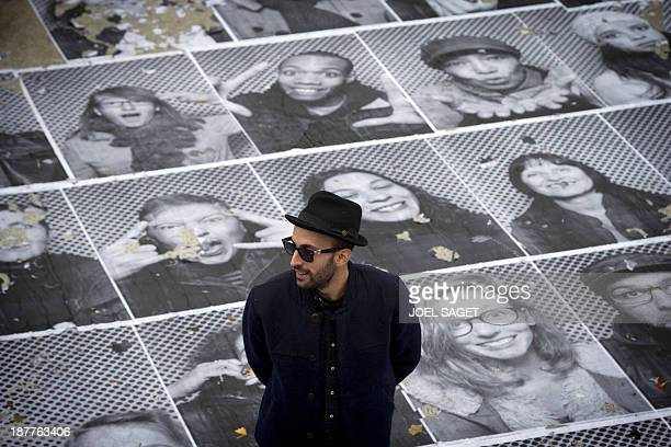 French artist and photographer JR poses during the installation of portraits from his Inside Out project on November 12 2013 in Paris To mark the...