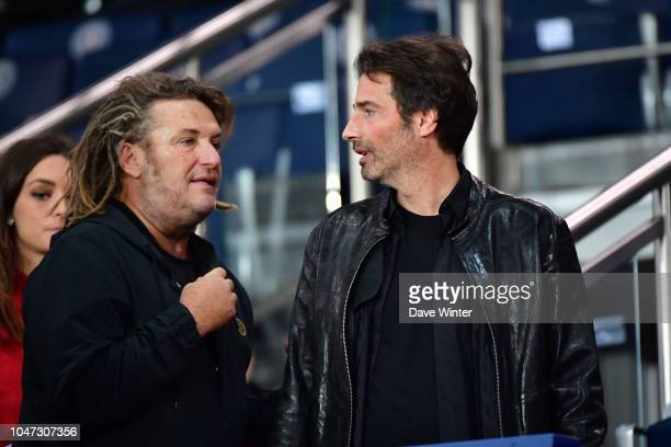 French artist and sculptor Richard Orlinski and French tv and radio presenter Olivier Delacroix during the Ligue 1 match between Paris Saint Germain...