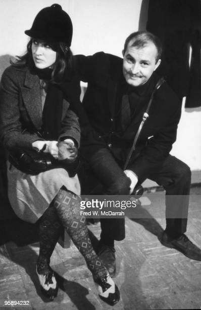 French artist Arman sits with an unidentified woman in a riding hat at art opening New York New York December 9 1963