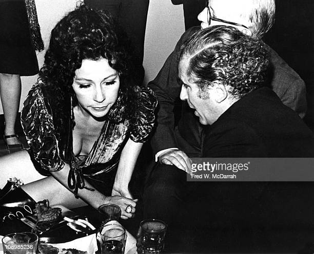 French artist author Ultra Violet leans forward as she listens to American author Norman Mailer at an unspecified event New York New York September 9...