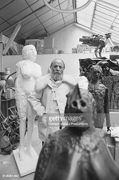 French artist Cesar stands in his Paris studio amid molds and sculpture