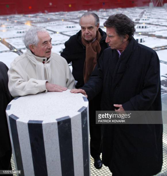 French artist Daniel Buren French Culture minister Frederic Mitterrand and former Culture minister Jack Lang speak together on January 8 2010 at the...