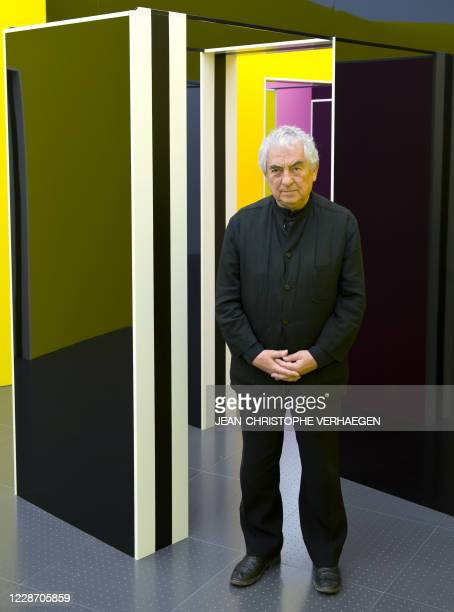 French artist Daniel Buren poses in front of his Cabanes eclatees imbriquees installation at the Centre PompidouMetz museum on May 6 2011 in Metz...