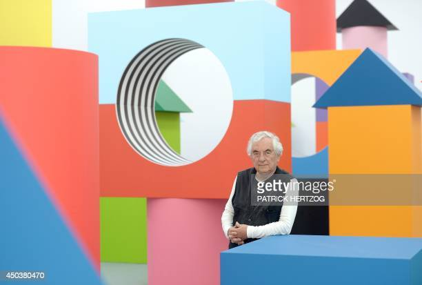 French artist Daniel Buren poses on June 10 2014 in front of his installation entitled Comme un jeu d'enfant travaux in situ at the Musee d'Art...