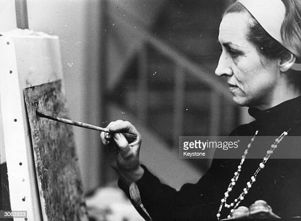 French artist Francoise Gilot who had two children by Pablo Picasso paints in her studio in Fulham London