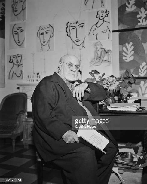 French artist Henri Matisse reading a book of poems by Yvan Goll at his desk in his villa in Vence, near Nice in the south of France, circa 1950. His...