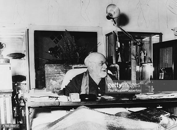 French artist Henri Matisse working on a table over his bed at his home in Cimiez, near Nice, France, 1st February 1951.