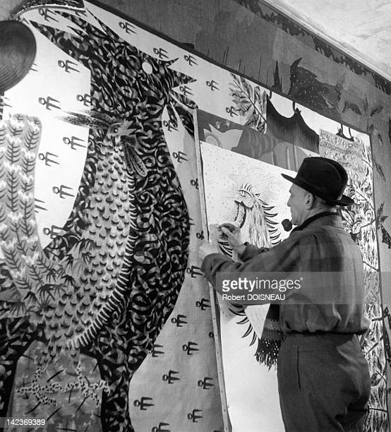 French artist Jean Lurcat in his workshop shown standing by the pattern for 'The Modern Apocalypse' in the 11th century castle where he lived Les...