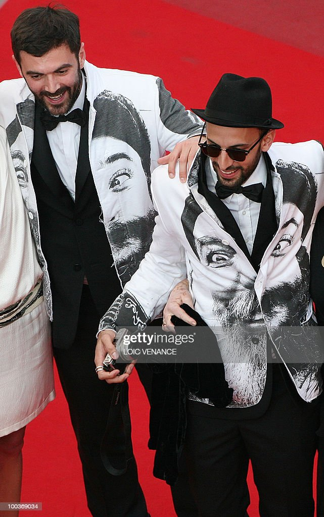 French artist JR (R) arrives for the screening of 'Des Hommes et des Dieux' (Of God and Men) presented in competition at the 63rd Cannes Film Festival on May 18, 2010 in Cannes.