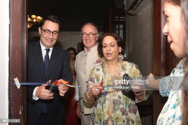 French artist Michel Testard Ambassador of France to India Alexandre Ziegler and Rajyashree Kumari Bikaner during a preview of painting exhibition...