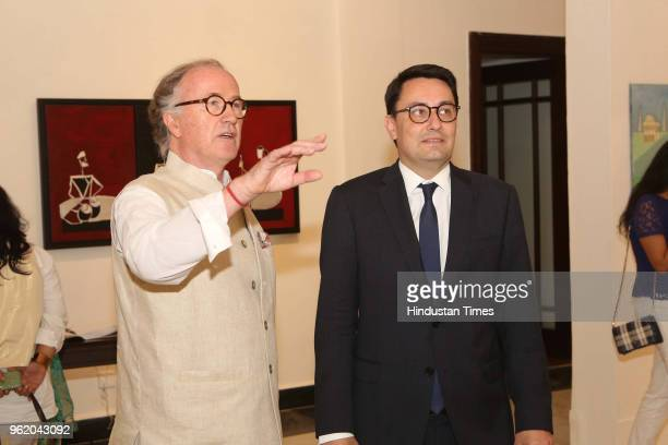 French artist Michel Testard and Ambassador of France to India Alexandre Ziegler during a preview of painting exhibition 'Glimpses of India' by...