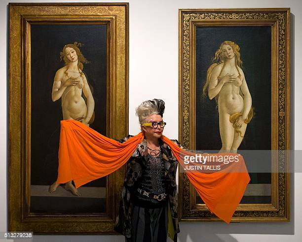 French artist Orlan poses for a photograph between between 'Venus 1490' and 'Venus 1490' both by Italian painter Sandro Botticelli during a photocall...