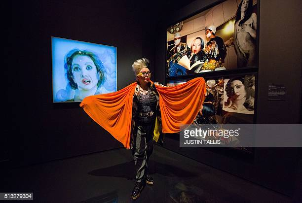 French artist Orlan poses for a photograph with her artworks entitled 'Hybridization of Botticelli's Venus and Orlan's Face' and '5th surgery...