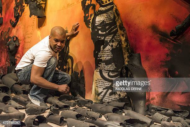 French artist Shuck One works on his installation entitled 'The march of history' part of the permanent exhibition at the Memorial ACTe the Caribbean...