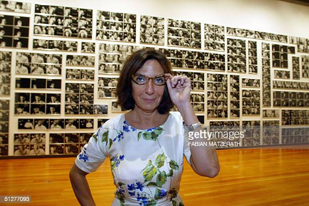 French artist Sophie Calle poses in front of her photo wall called Cash Machine 09 September 2004 in Berlin The German capital is the first stop in...