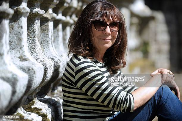 French artist Sophie Calle poses in Mellionnec western of France on June 13 2014 As part of the Lieux mouvants art performance French artist Sophie...