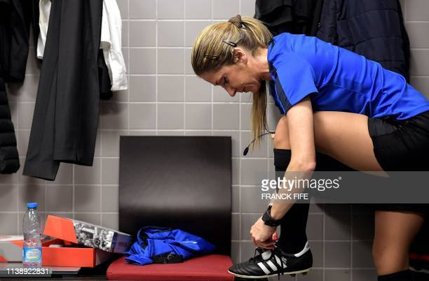French assistant referee Manuela Nicolosi gets ready for the French L2 football match between Valenciennes and Beziers on April 19 2019 at the...