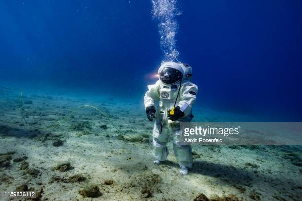 French astronaut Jean-François Clervoy of the European Space Agency in a space suit attempts a Moonwalk under the sea on September 4, 2013 off the...