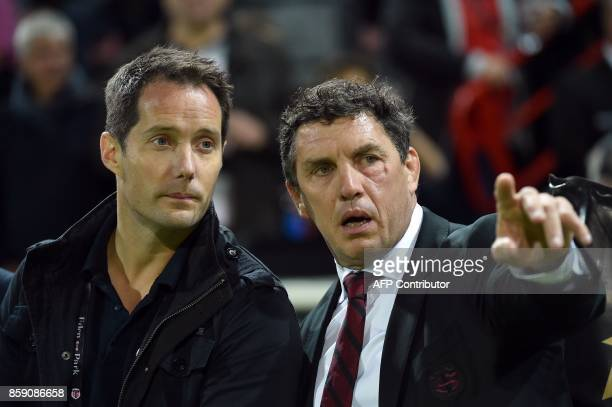 French astronaut Thomas Pesquet listens to Toulouse's president Didier Lacroix during the French Top 14 rugby union match Stade Toulousain vs...