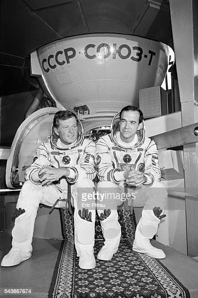 French astronauts JeanLoup Chretien and Patrick Baudry in space suits in front of the Soviet Soyuz T6 that Chretien will travel in for next year's...