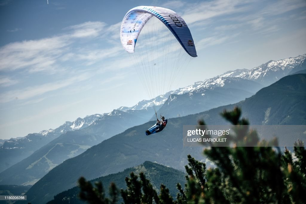 TOPSHOT - French athlete Benoit Outters flies with his paraglider
