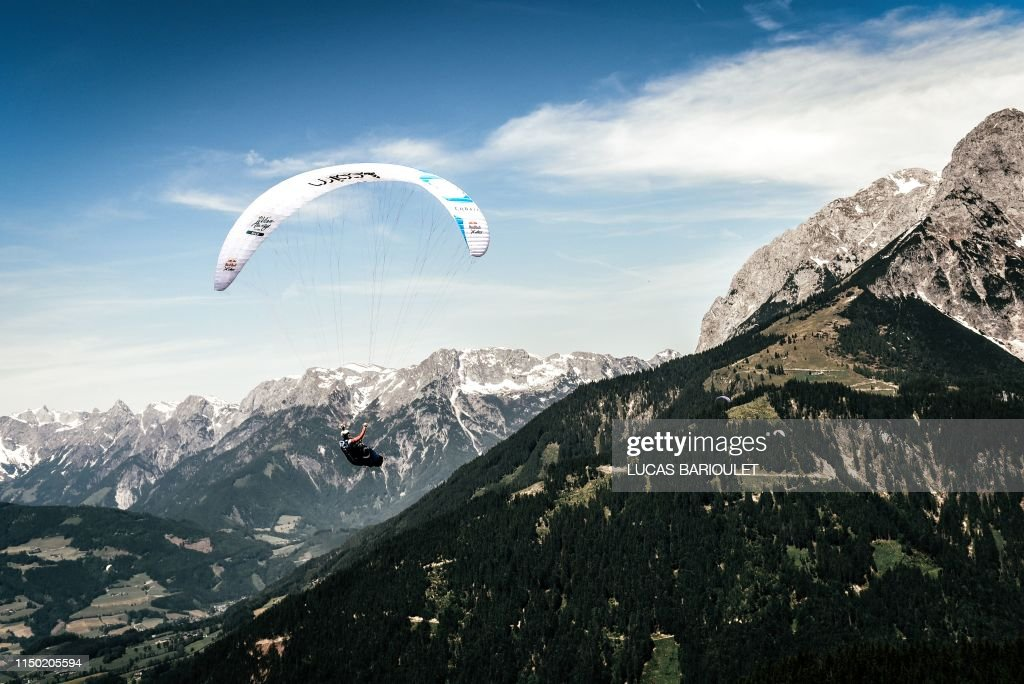 French athlete Benoit Outters flying with his paraglider during a