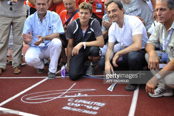 French athlete Christophe Lemaitre poses after signing the line 4 to celebrate his victory in the men's 200m final during the French national...