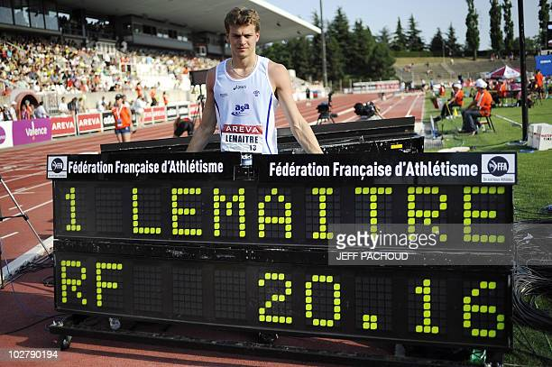 French athlete Christophe Lemaitre poses behind the time board after his victory in the men's 200m final during the French national athletics...