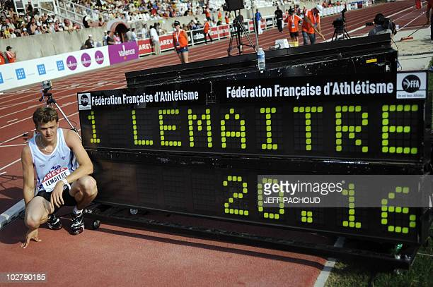 French athlete Christophe Lemaitre poses near the time board after his victory in the men's 200m final during the French national athletics...