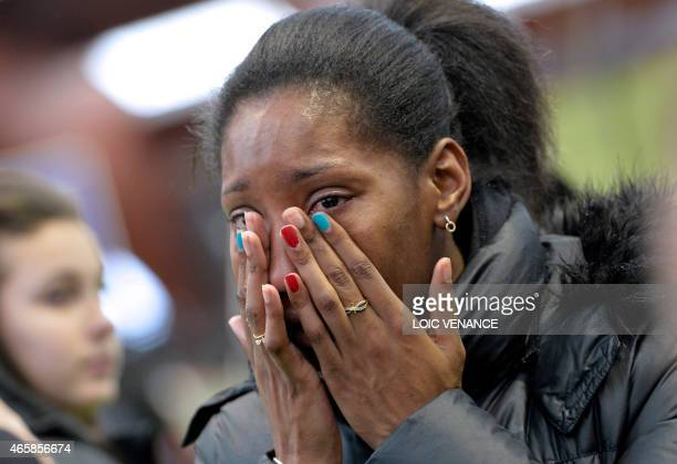 French athlete Eloyse Lesueur cries on March 11 2015 at the Insep national Sport Institute in Vincennes outside Paris during a ceremony in memory of...