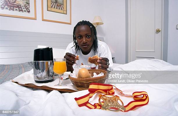 French athlete Eunice Barber having breakfast after winning Gold in the women's heptathlon of the 1999 IAAF World Championships