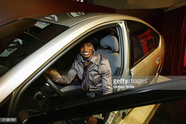 French athlete Eunice Barber sits in the new Toyota Prius car on July 3 2003 The car will be used as the lead vehicle in the marathon races during a...