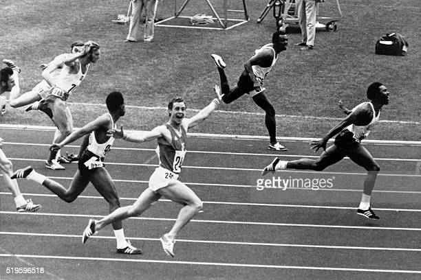 French athlete Guy Drut and US Rodney Milburn race during the 110 meters hurdles on September 07, 1972 at the Olympic Games in Munich. / AFP / -