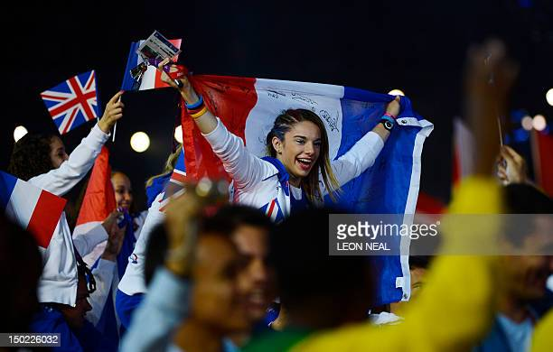 French athlete holds her national flag during the closing ceremony of the 2012 London Olympic Games at the Olympic stadium in London on August 12,...