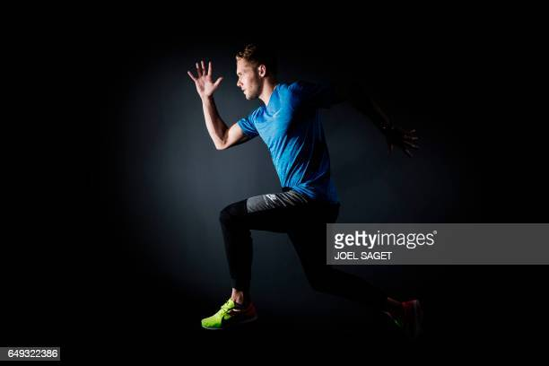 TOPSHOT French athlete Kevin Mayer poses during a photo session in Paris on March 7 2017 / AFP PHOTO / JOEL SAGET