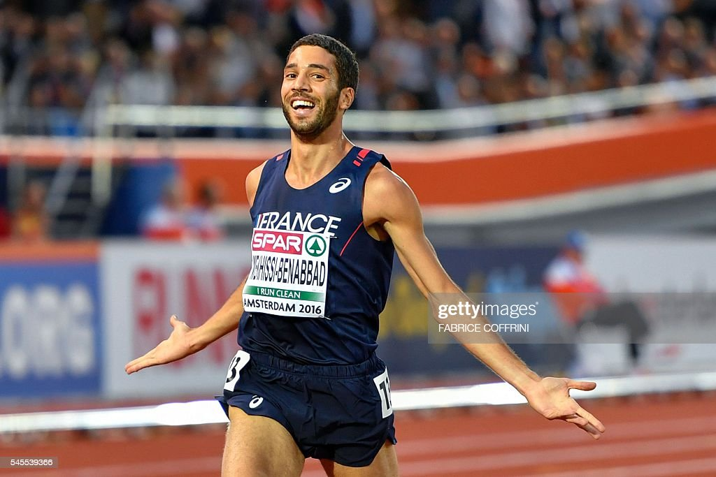 French athlete Mahiedine Mekhissi-Benabbad crosses the finish line to win the Men's 3000m steeplechase during the European Athletics Championships at the Olympic Stadium in Amsterdam, on July 8, 2016. / AFP / FABRICE