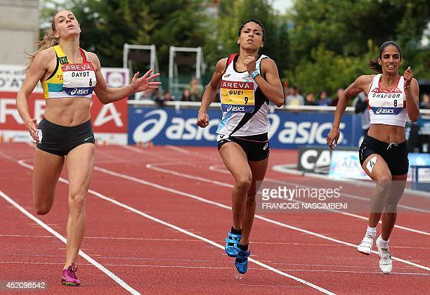 French athlete Marie Gayot competes and wins the women's 400m event ahead of French athletes Floria Guei and Madiea Ghafoor on July 13 2014 during...