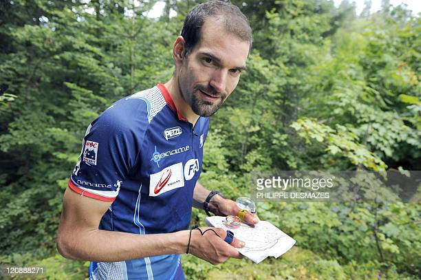 FEBVRE French athlete Thierry Gueorgiou seventime world champion of orienteering trains on August 5 2011 near SaintFrançoisdeSales French Alps before...
