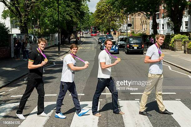 French athletes Amaury Leveaux Fabien Gilot Clement Lefert and Yannick Agnel walking on the pedestriancrossing of Abbey Road with their medals in the...