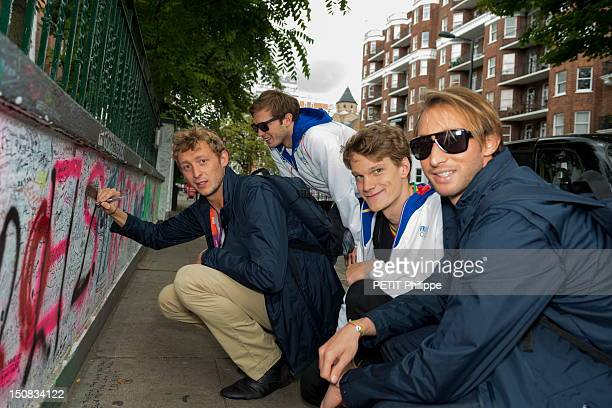 French athletes Amaury Leveaux Fabien Gilot Clement Lefert and Yannick Agnel sign the wall at Abbey Road studios in the city of London on August 6...