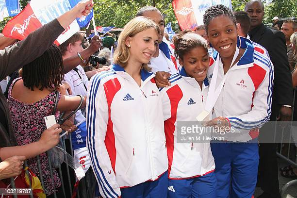 French athletes Celine Distel, Nelly Banco and Lina Jacques-Sebastien attend a ceremony at the official sponsor store Adidas on the Champs Elysee...