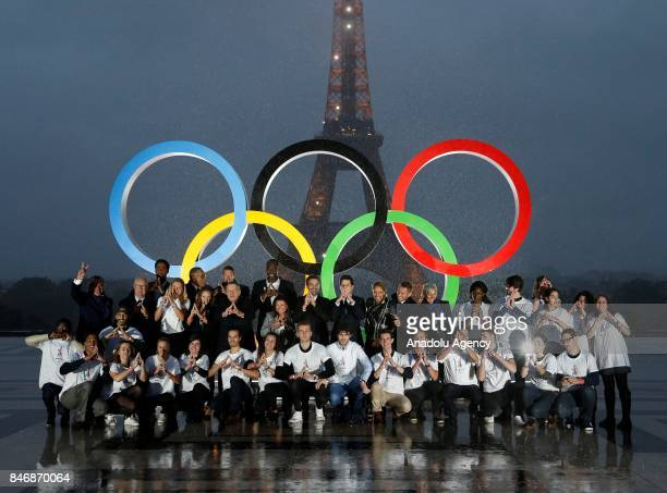 French athletes pose in front of Olympic rings to celebrate the Paris 2024 Olympic bid victory in Paris France on September 14 2017