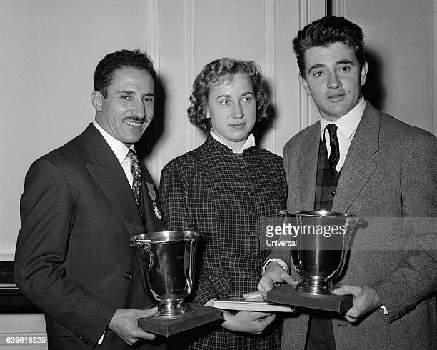 French athletes received by the Minister of Education after the 1956 Olympics Alain Mimoun who won the Marathon Marthe Lambert and fencing champion...